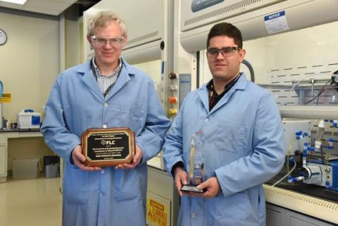 Two researchers hold awards