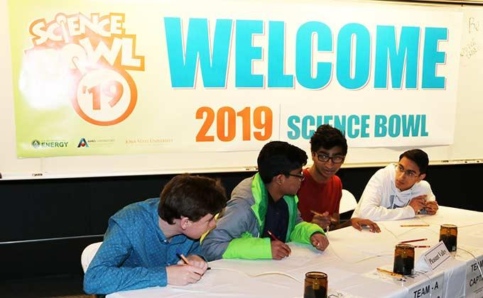 Team members confer during the 2019 Ames Laboratory High School Science Bowl