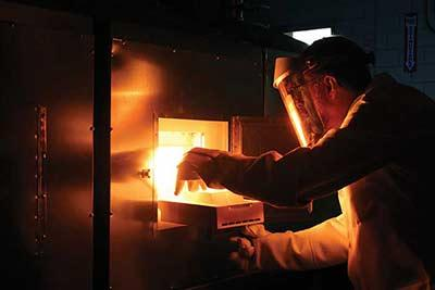 Researcher Paul Canfield removing a sample from a flux-growth furnace